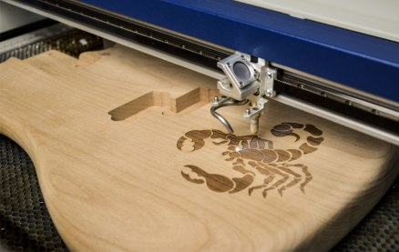 wood-guitar-engraving